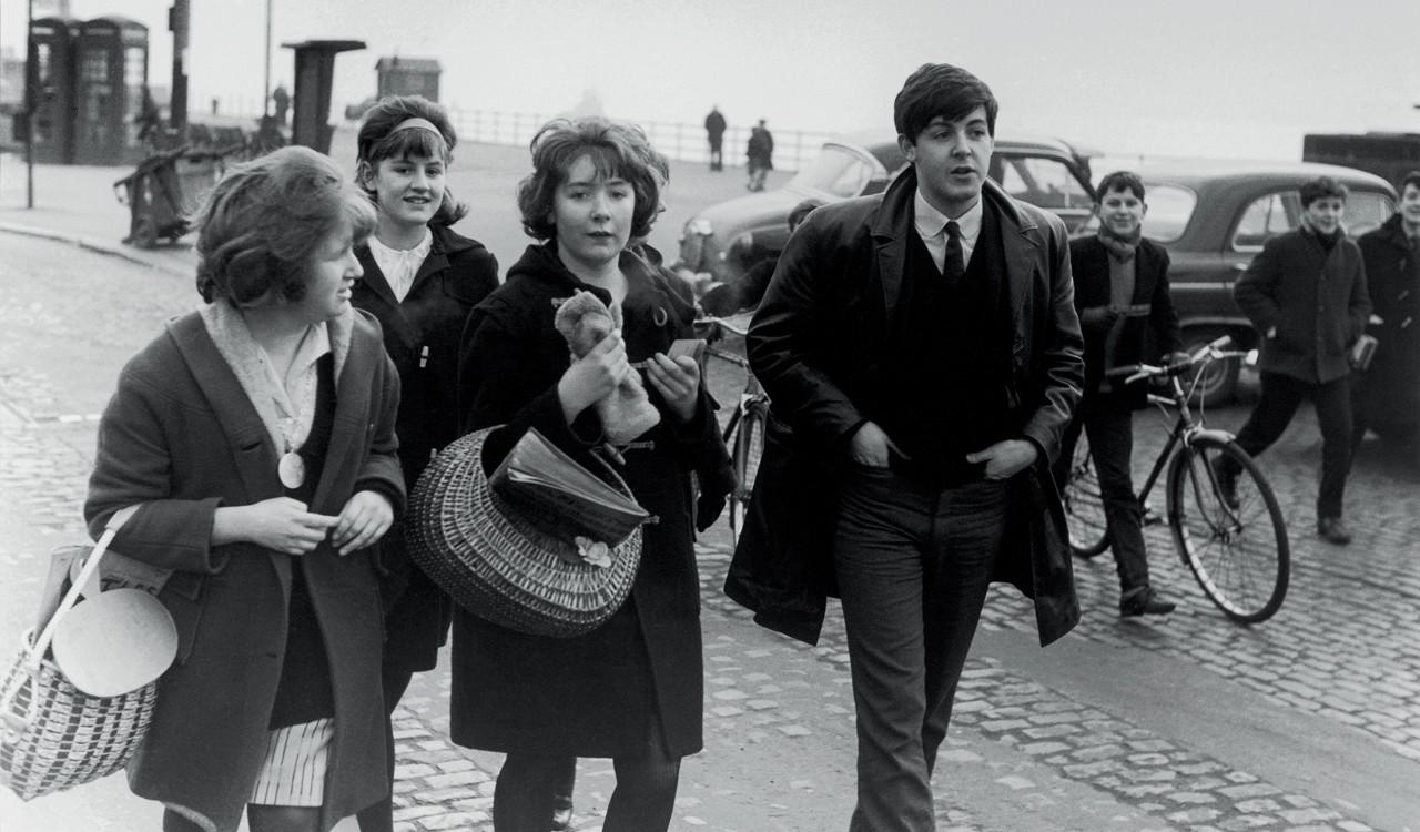Paul McCartney walking with fans in Liverpool, 1963